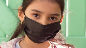 Child wearing a mask during Covid-19