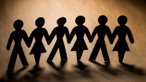 people holding hands as a sign of unity